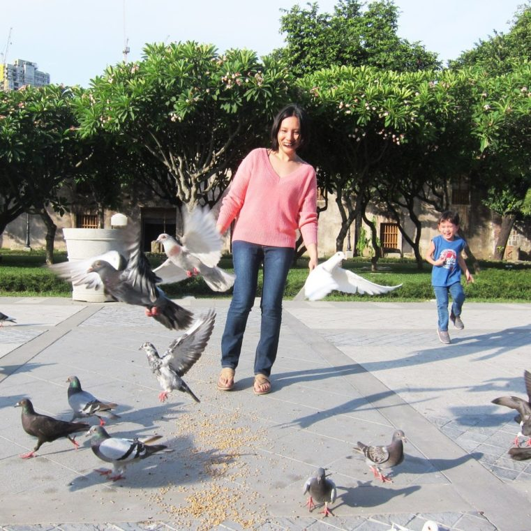 Kim playing with doves