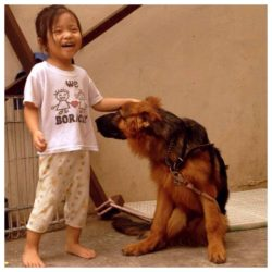 Michael's daughter with his dog
